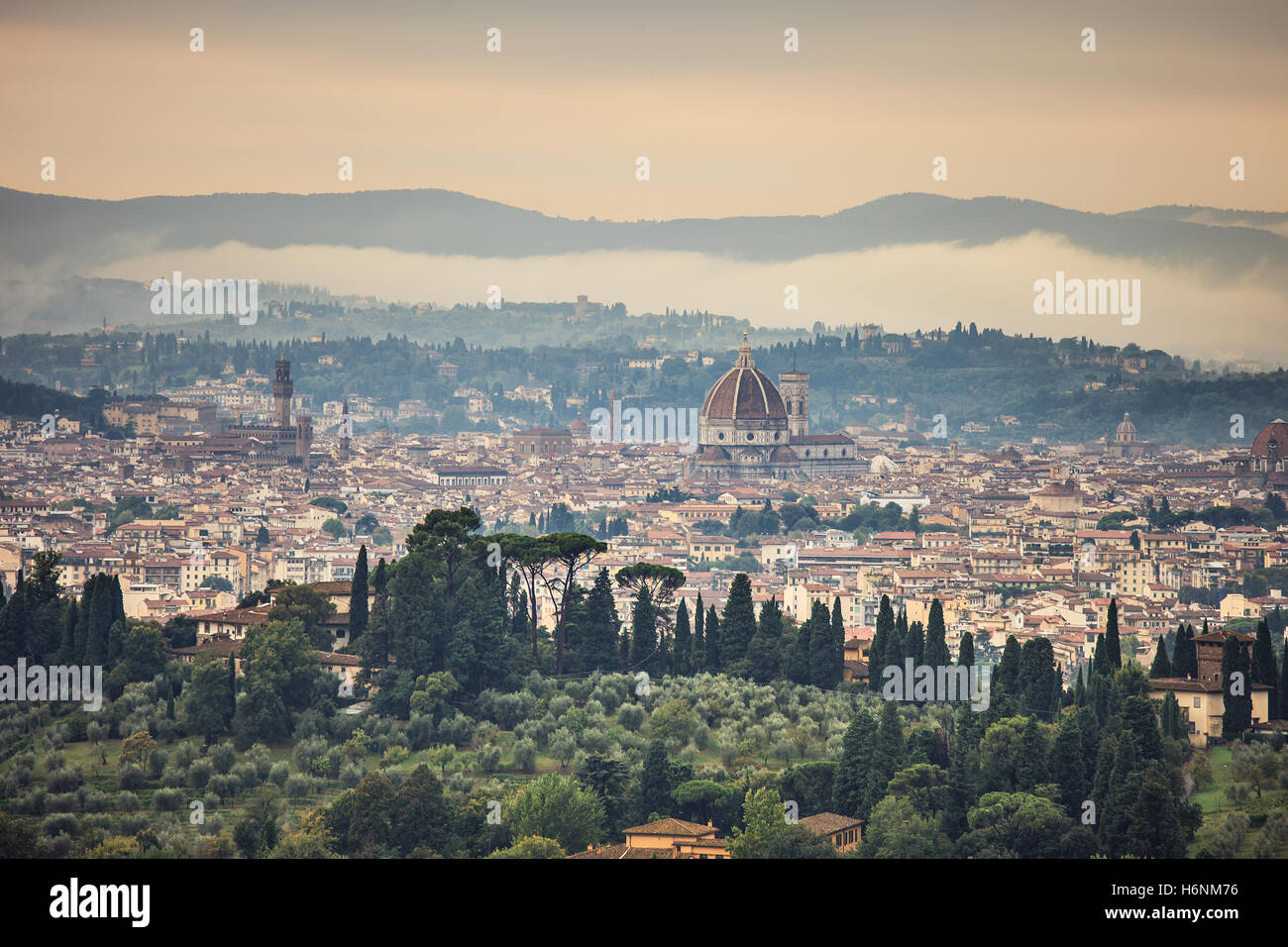 Florence or Firenze aerial foggy morning cityscape. Panorama view from Fiesole hill. Palazzo Vecchio and Duomo Cathedral. - Stock Image