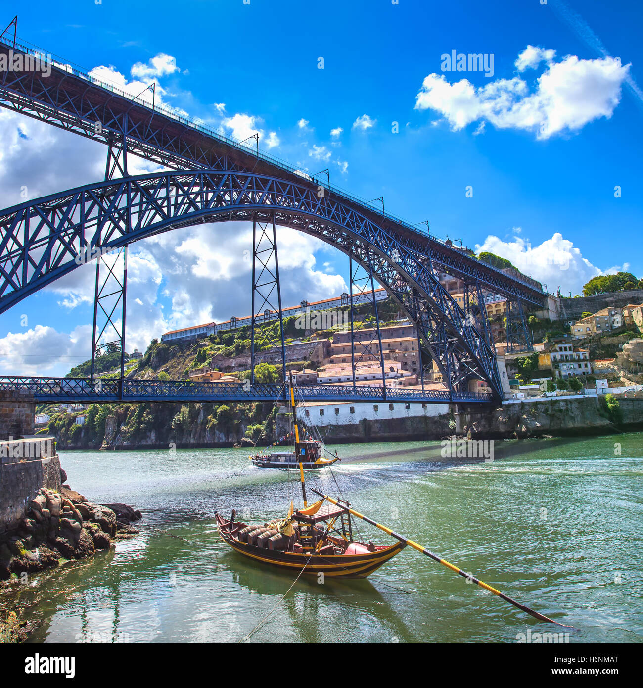 Oporto or Porto city skyline, Douro river, traditional boats and Dom Luis or Luiz iron bridge. Portugal, Europe. - Stock Image