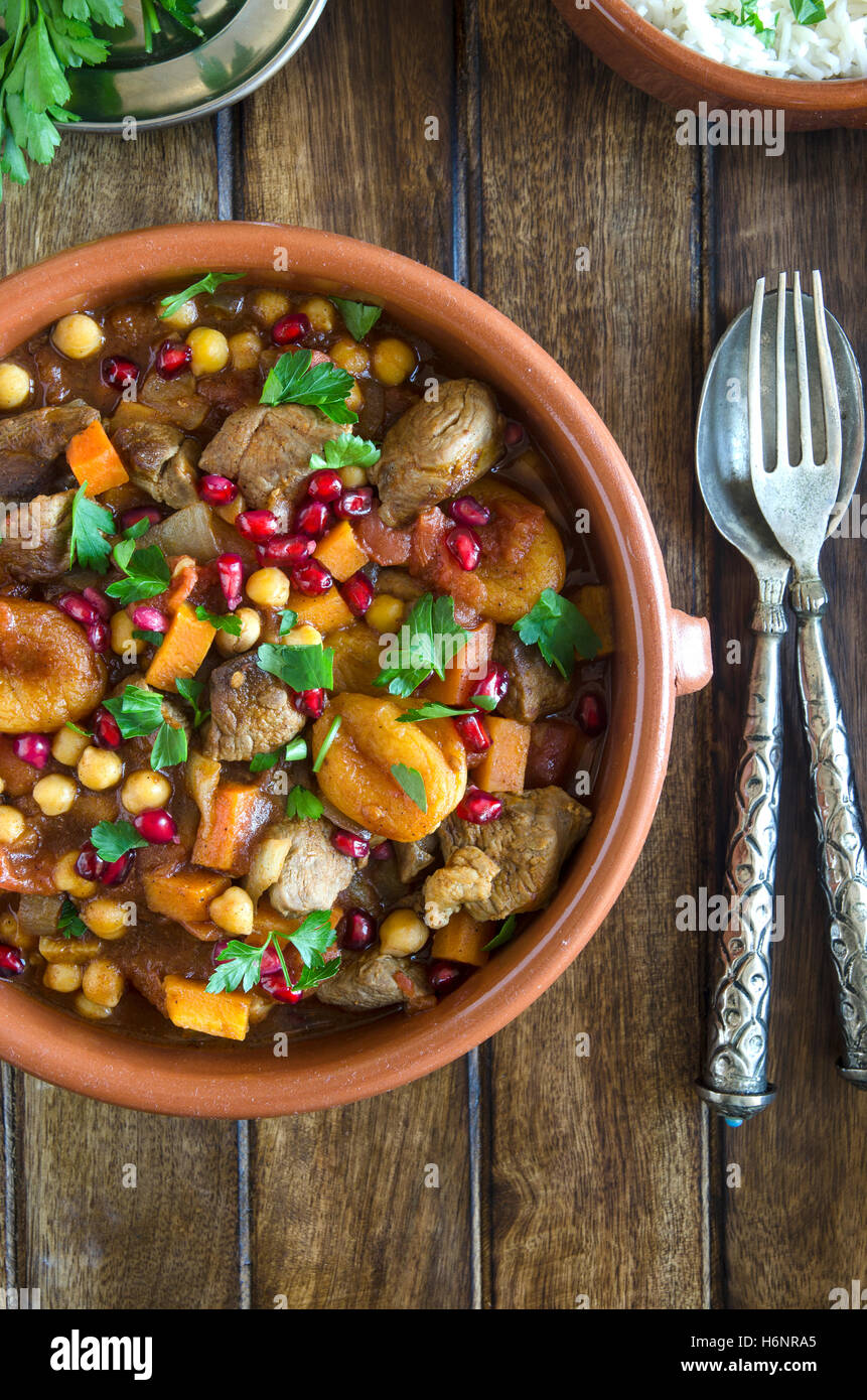 Lamb tagine with chickpeas, apricots and pomegranate seeds - Stock Image