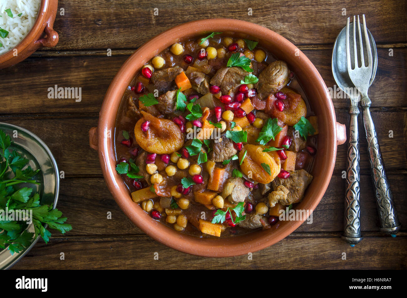 Lamb tagine with chickpeas, apricots and pomegranate seeds Stock Photo