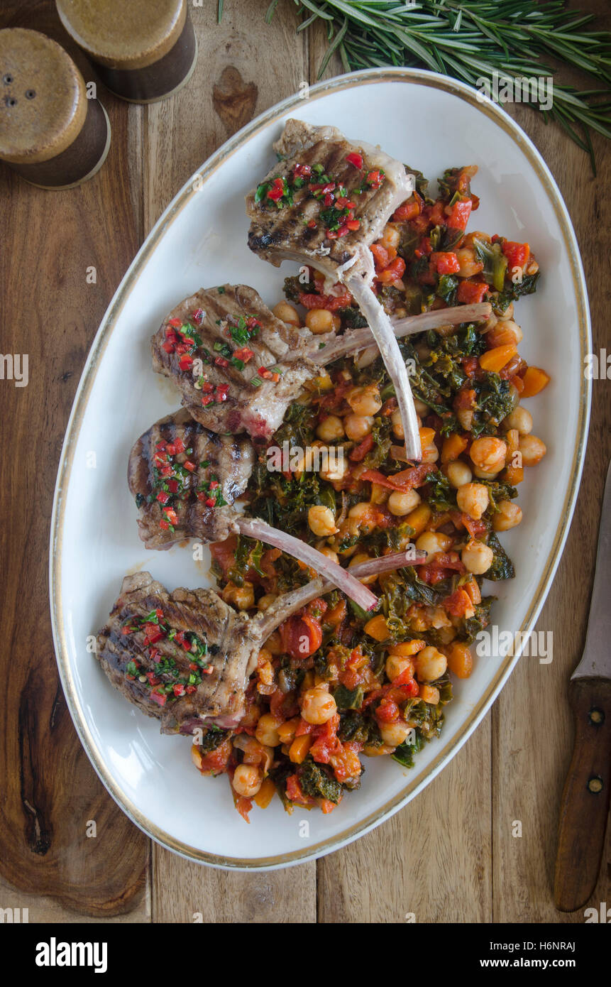 Lamb chops with braised chickpeas and chard - Stock Image