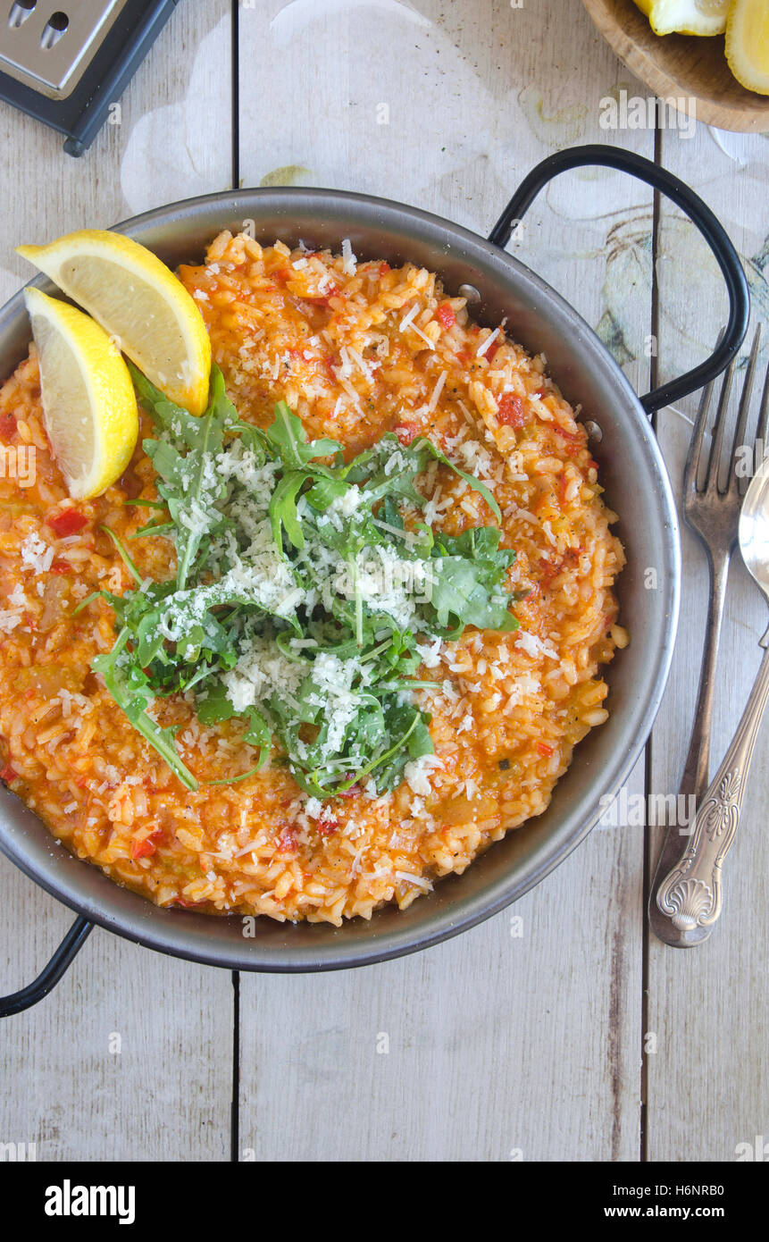 Red pepper risotto with Parmesan and rocket - Stock Image