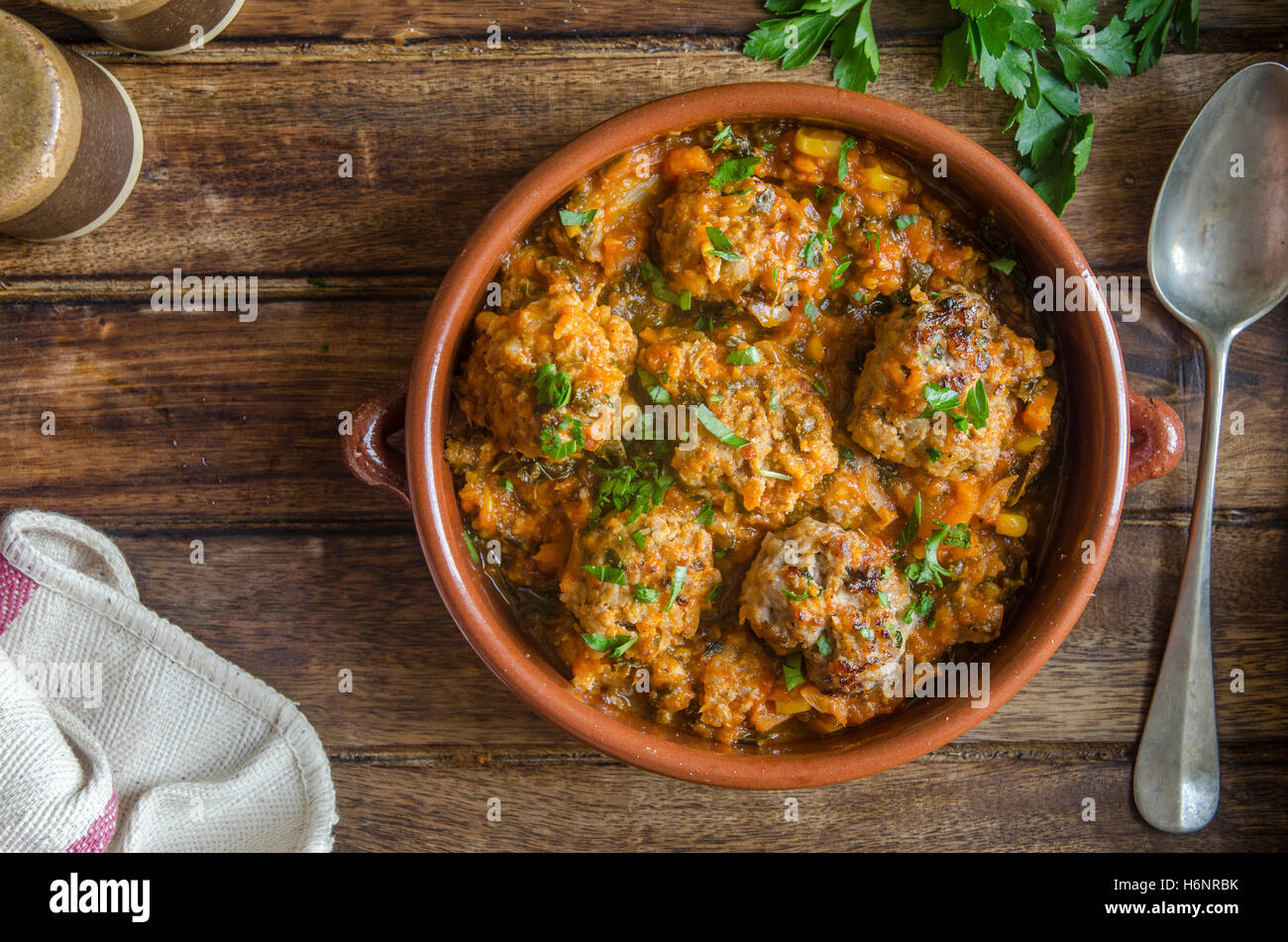 Pork and apple meatballs in a ceramic dish - Stock Image