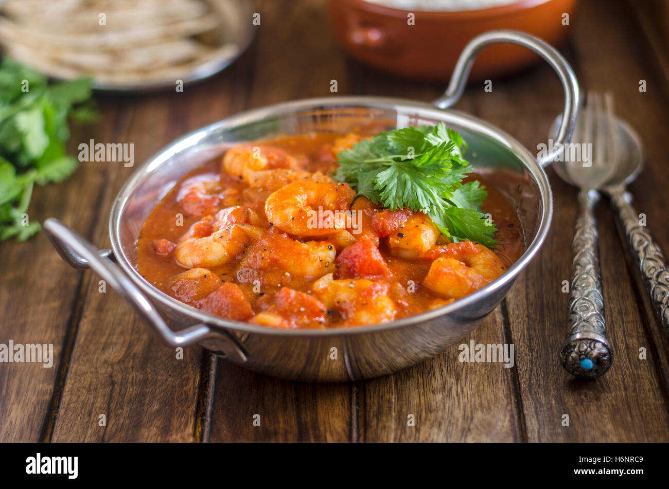 Indian prawn curry with rice and chapatis - Stock Image