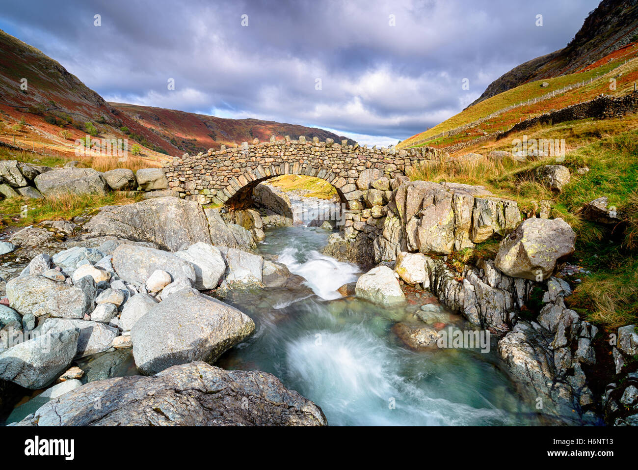 Stocley Bridge crossing the river Derwent near Seathwaite in the Lake District National Park in Cumbria. - Stock Image