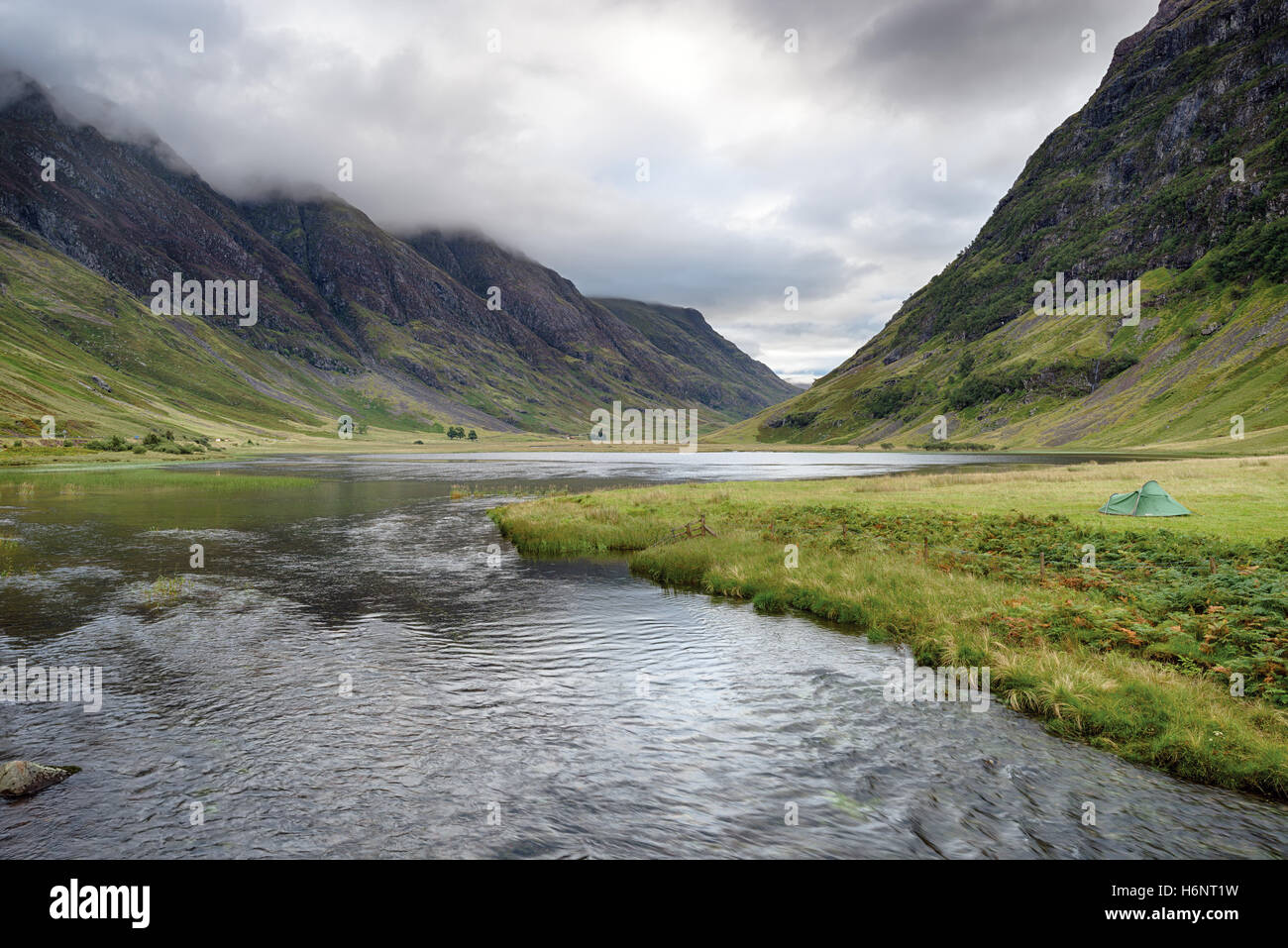 A tent on the shores of Loch Achtriochtan at Glencoe in the highlands of Scotland - Stock Image