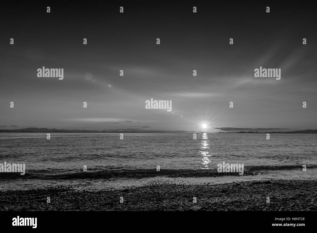 Point Roberts sunset  at moonlight over the beach with cranes in background, Washington State, USA - black and white - Stock Image