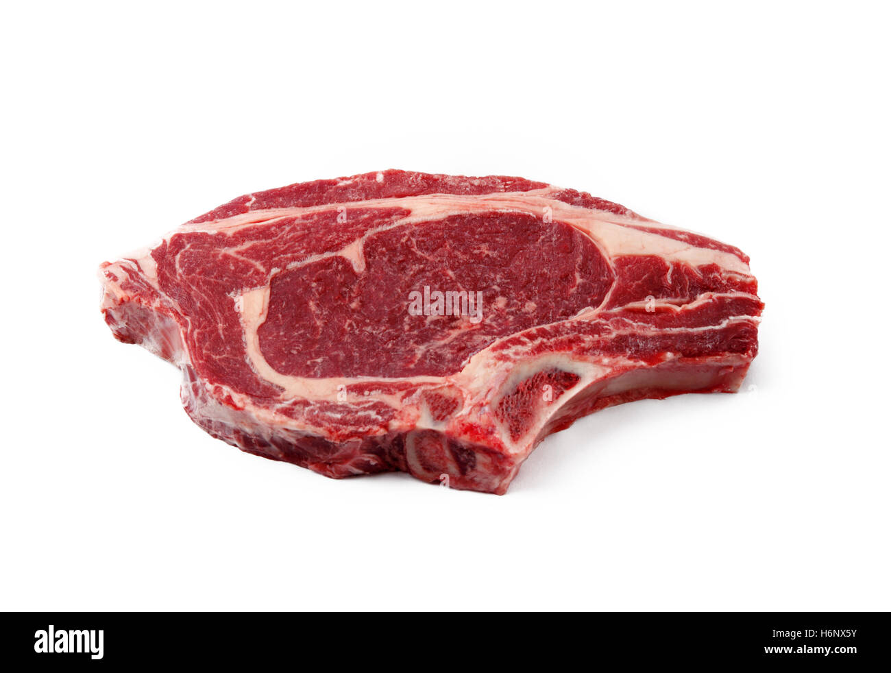 Organic juicy red meat  a steak isolated on a white background - Stock Image