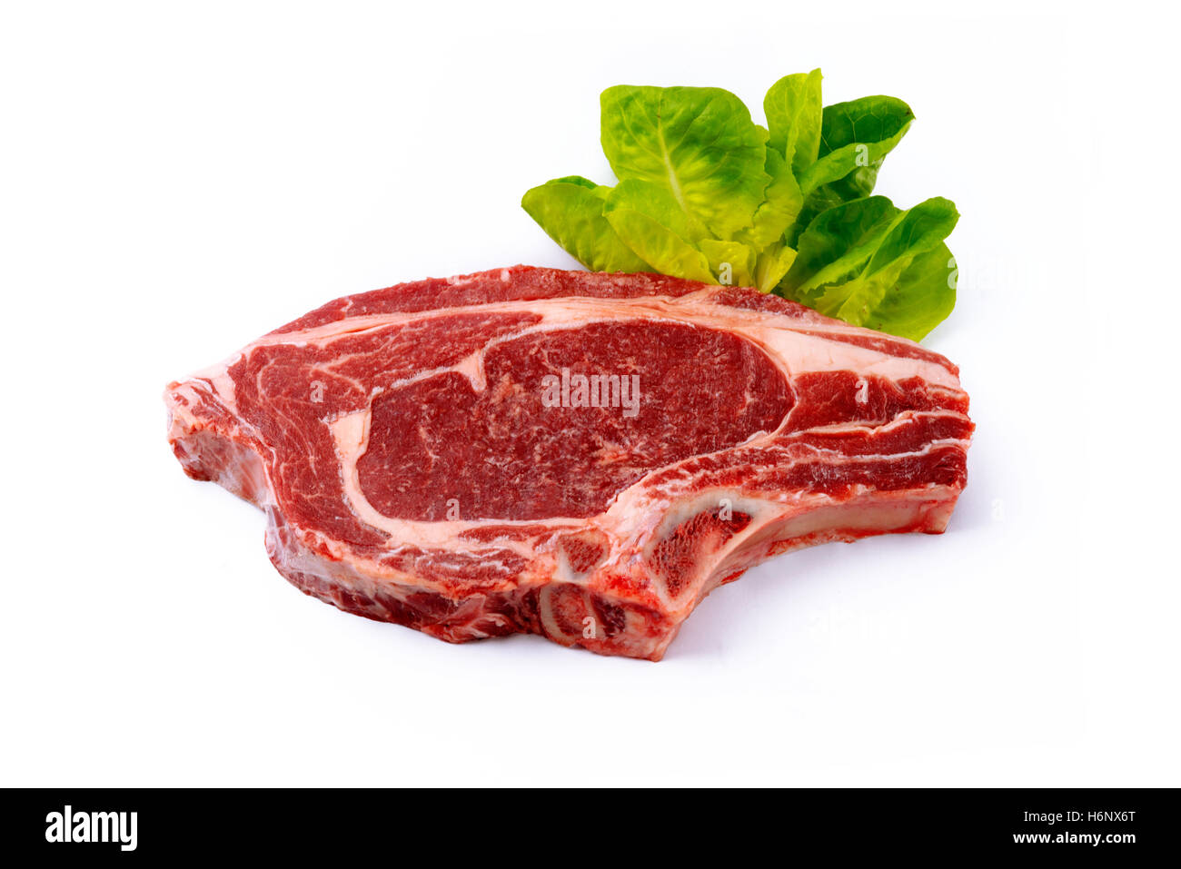 succulent organic tender steak with lettuce isolated on a bright white background with room for text and copy space - Stock Image