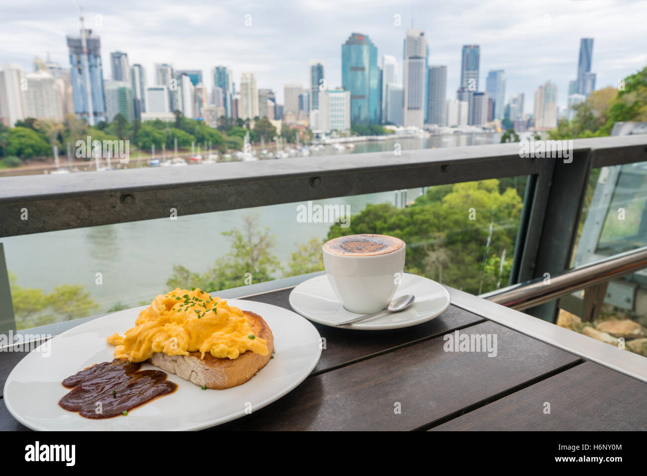 Breakfast in a cafe with city background - Stock Image
