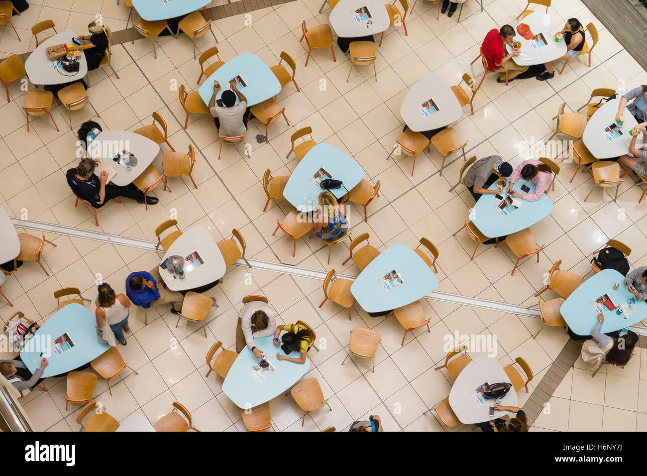 People dining in food court in Brisbane - Stock Image