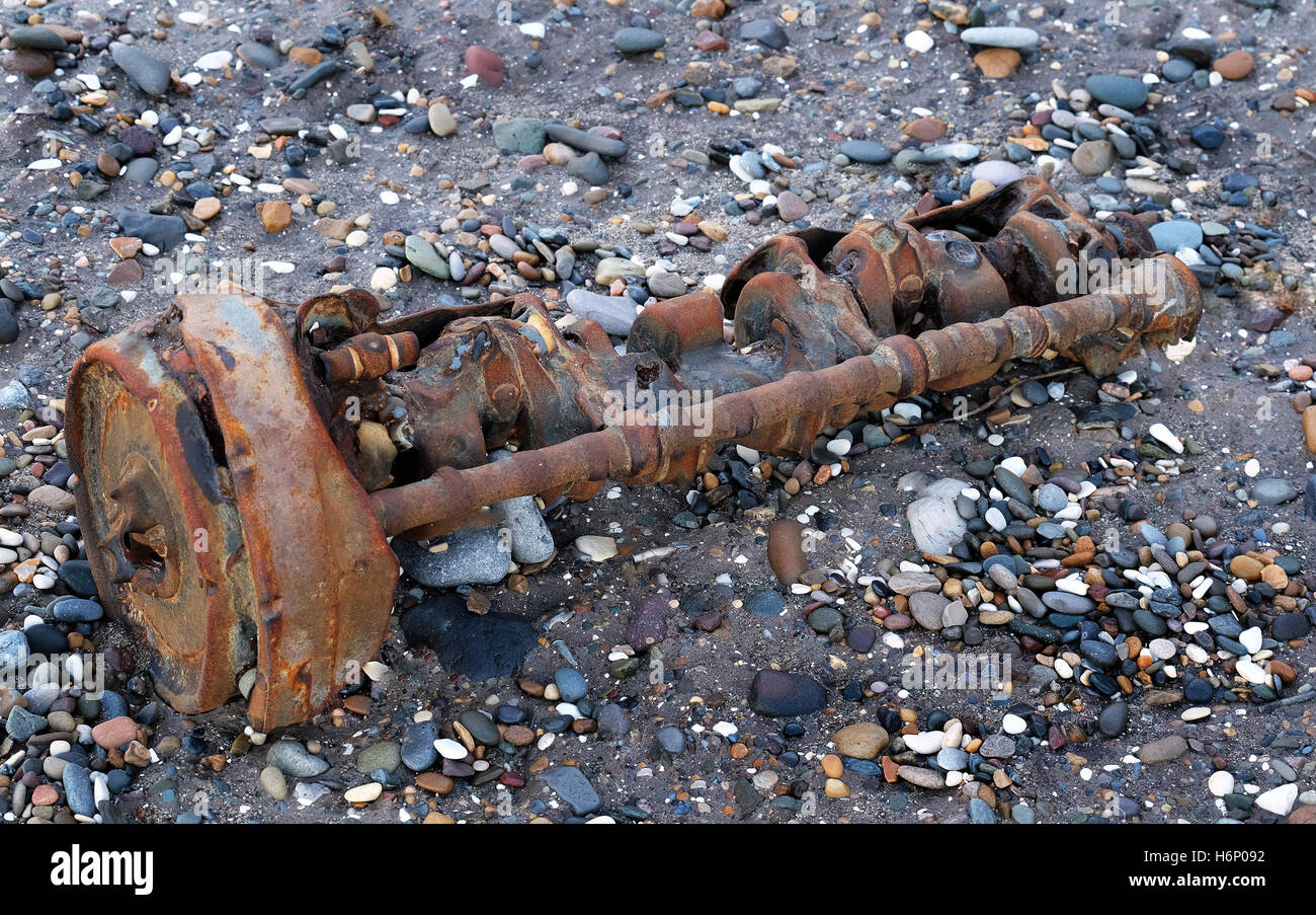 Part of old world war two engine on beach at Skipsea, North yorkshire, UK. - Stock Image
