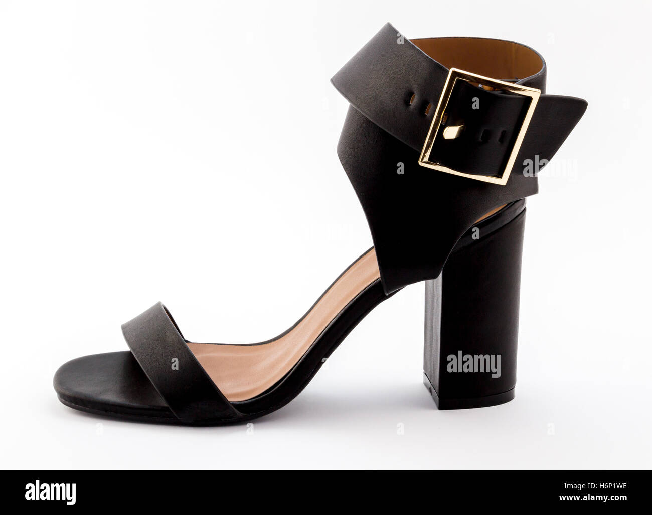 Female wide strapped black high heel sandal isolated on white - Stock Image
