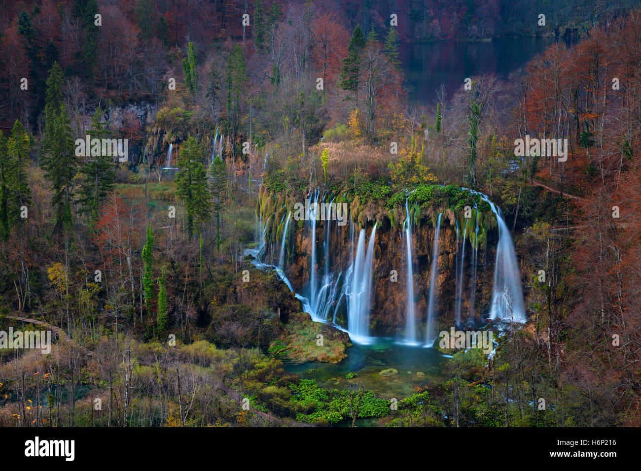 Plitvice Waterfall in autumn. Image of waterfall located in Plitvice national park, Croatia during autumn dawn. - Stock Image