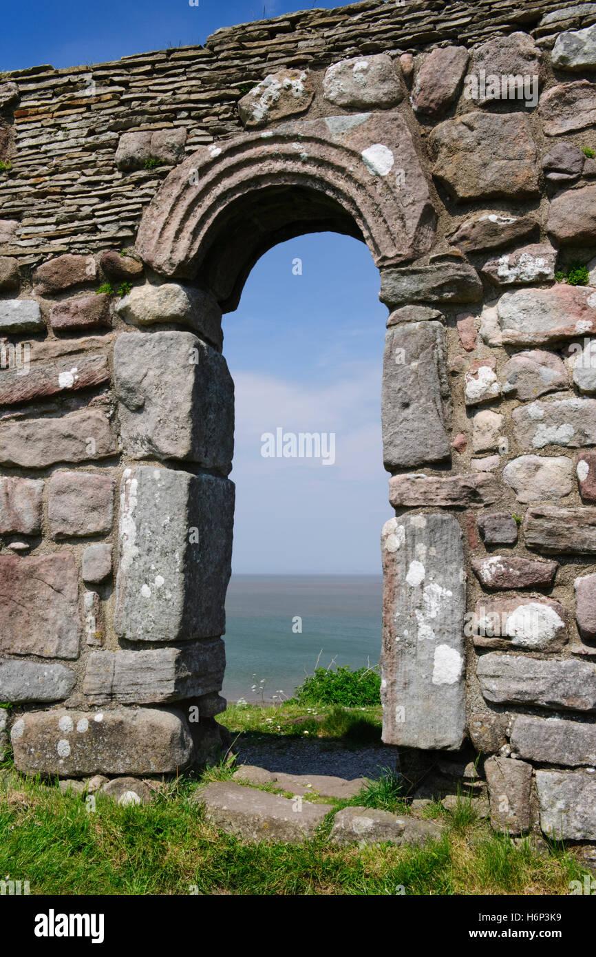 St Patrick's Chapel, Heysham, overlooking Morecambe Bay, Lancashire: S doorway, C8th Anglo-Saxon with upright jamb Stock Photo