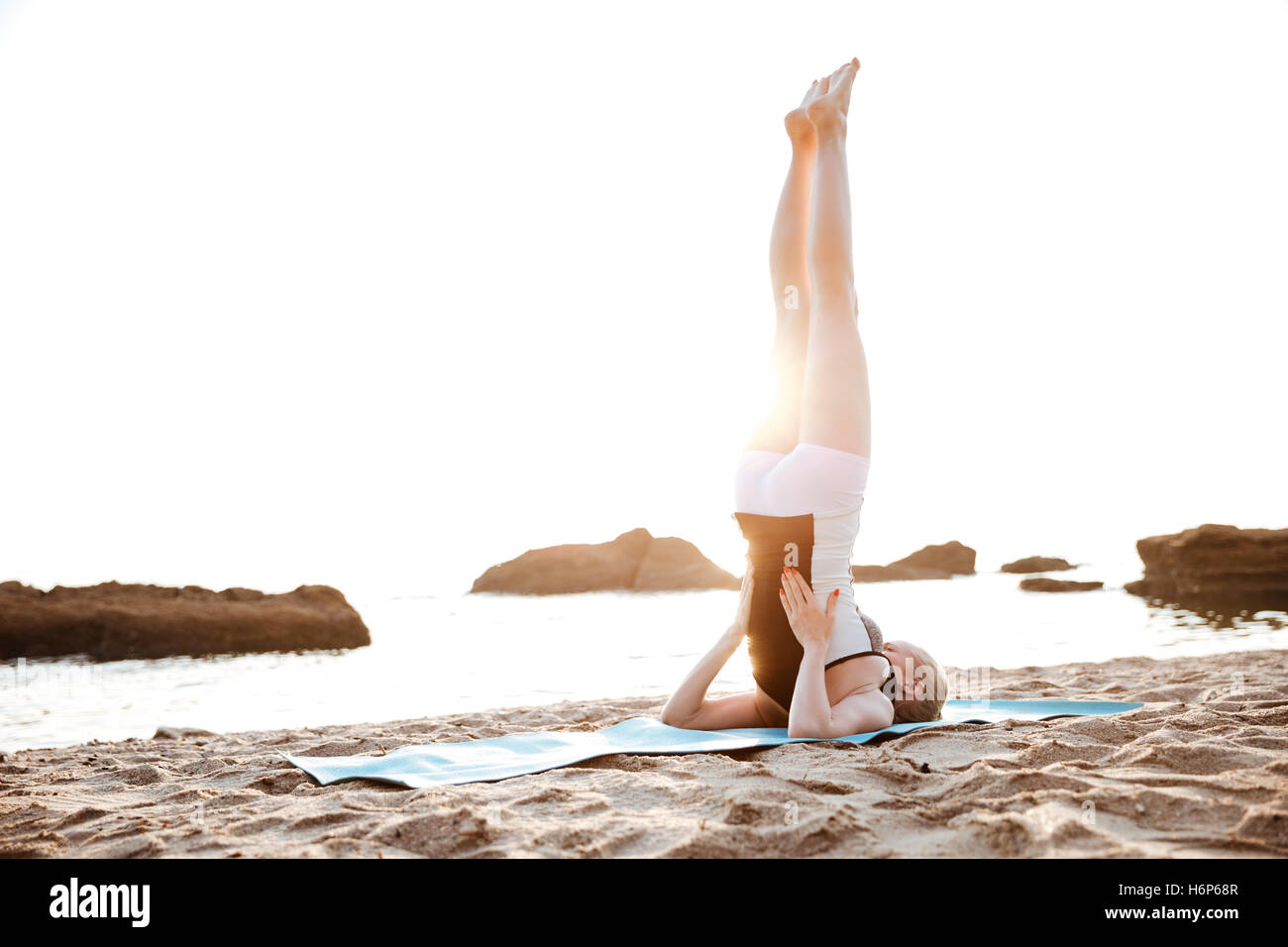 Portrait of a young woman doing fitness exercises outdoors in the morning Stock Photo
