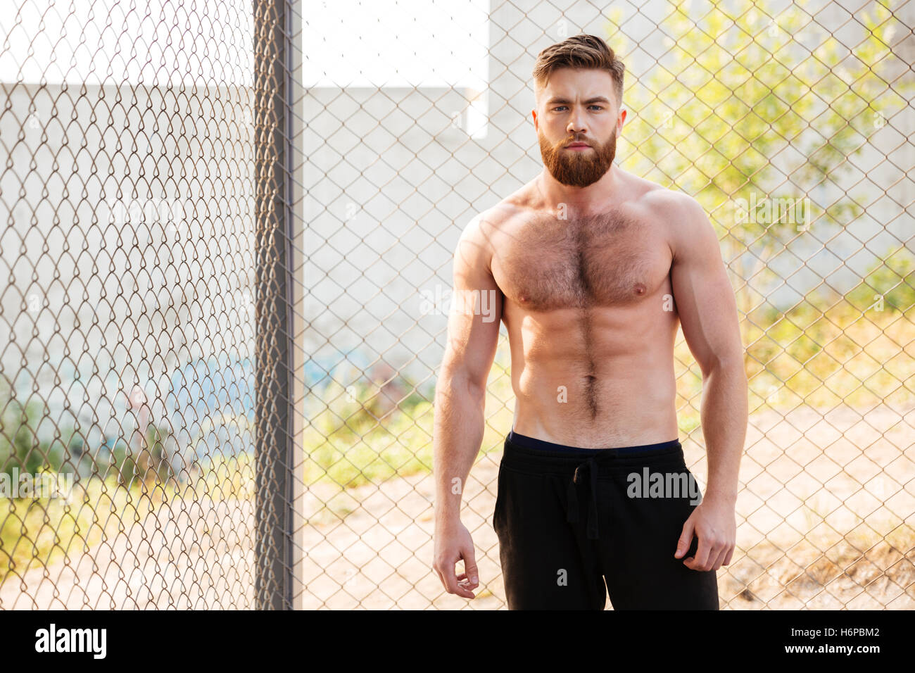 Handsome young shirtless fitness man during workout outdoors Stock Photo