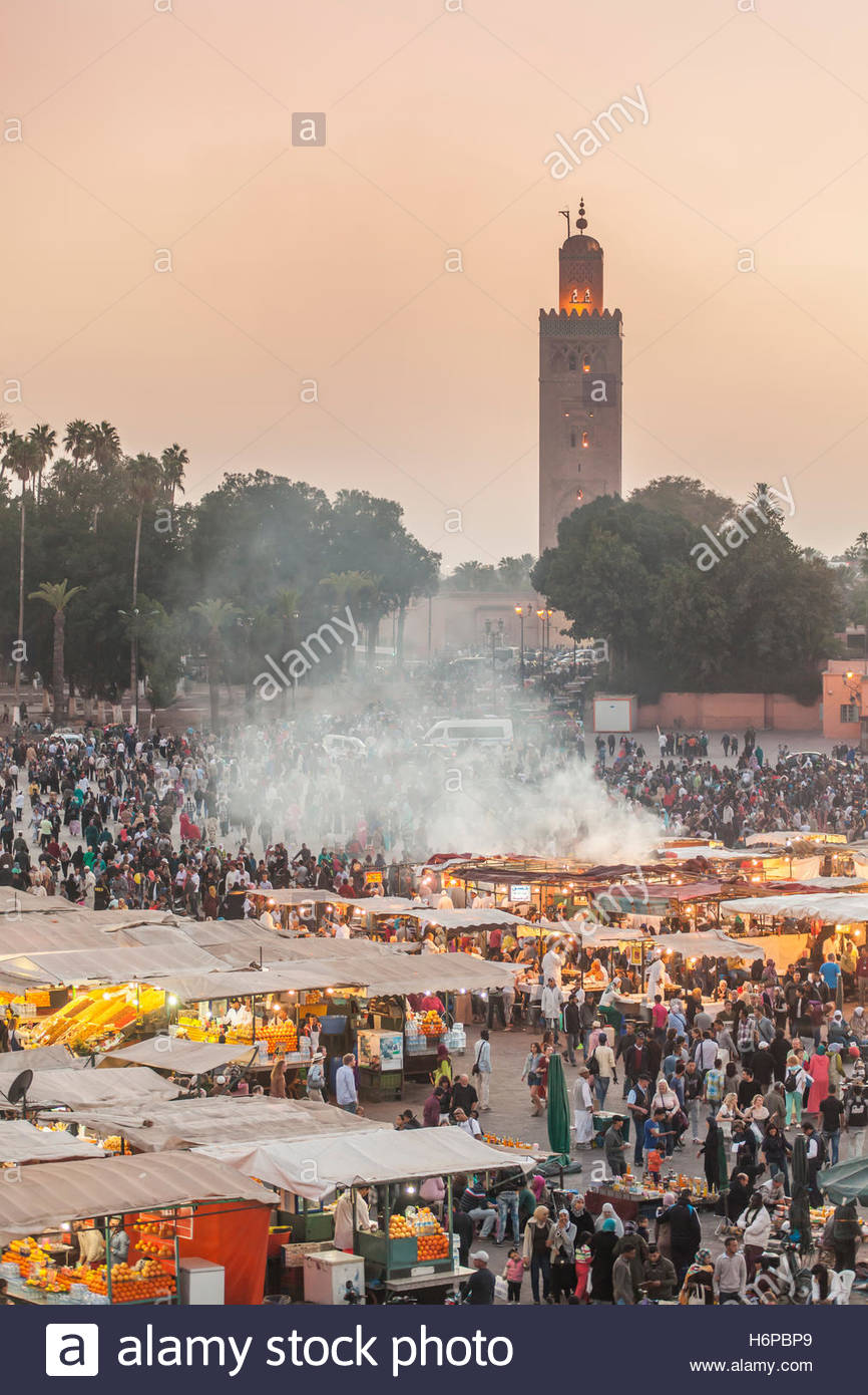 Djemaa el Fna or Jamaa el Fna square is a North Africa's equivalent to a three ring circus, with snake-charmers, Stock Photo