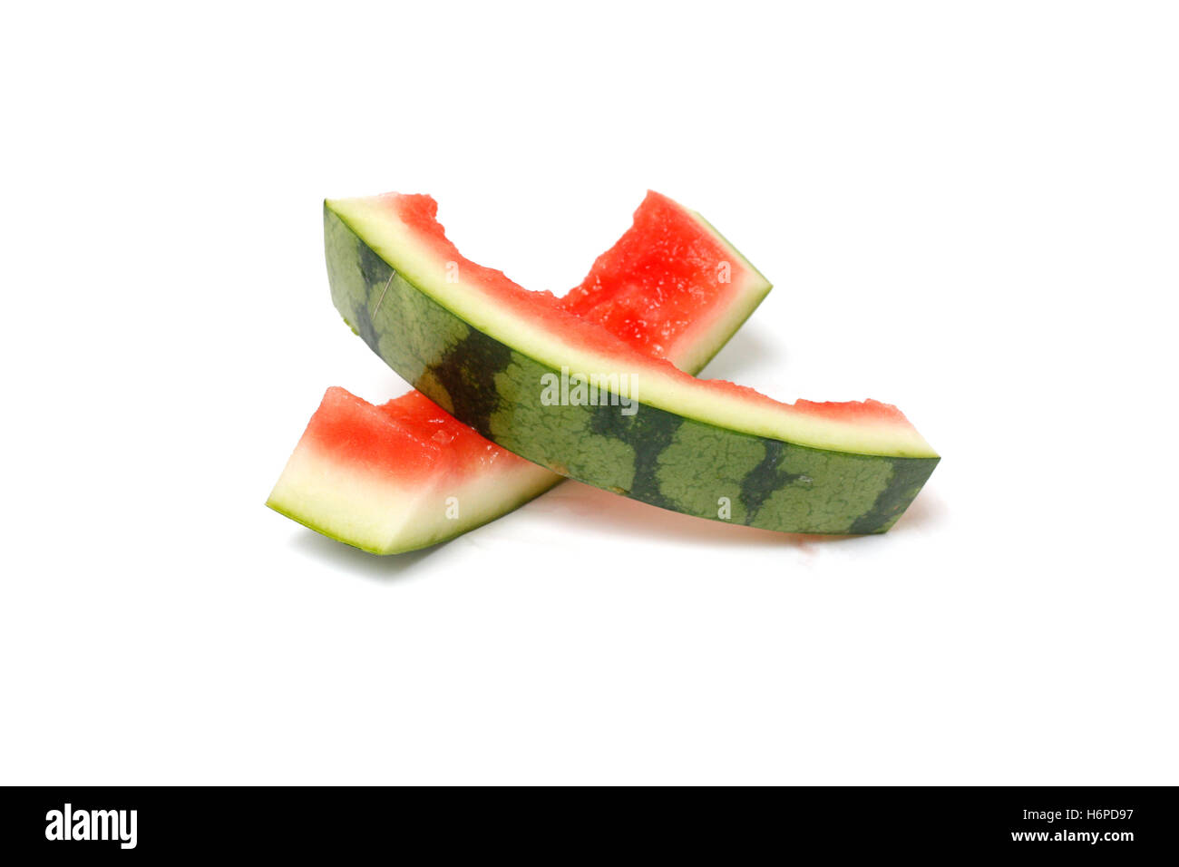 food aliment isolated teeth bit summer summerly reflection ripe fruit refreshing cut juicy half watermelon marks - Stock Image