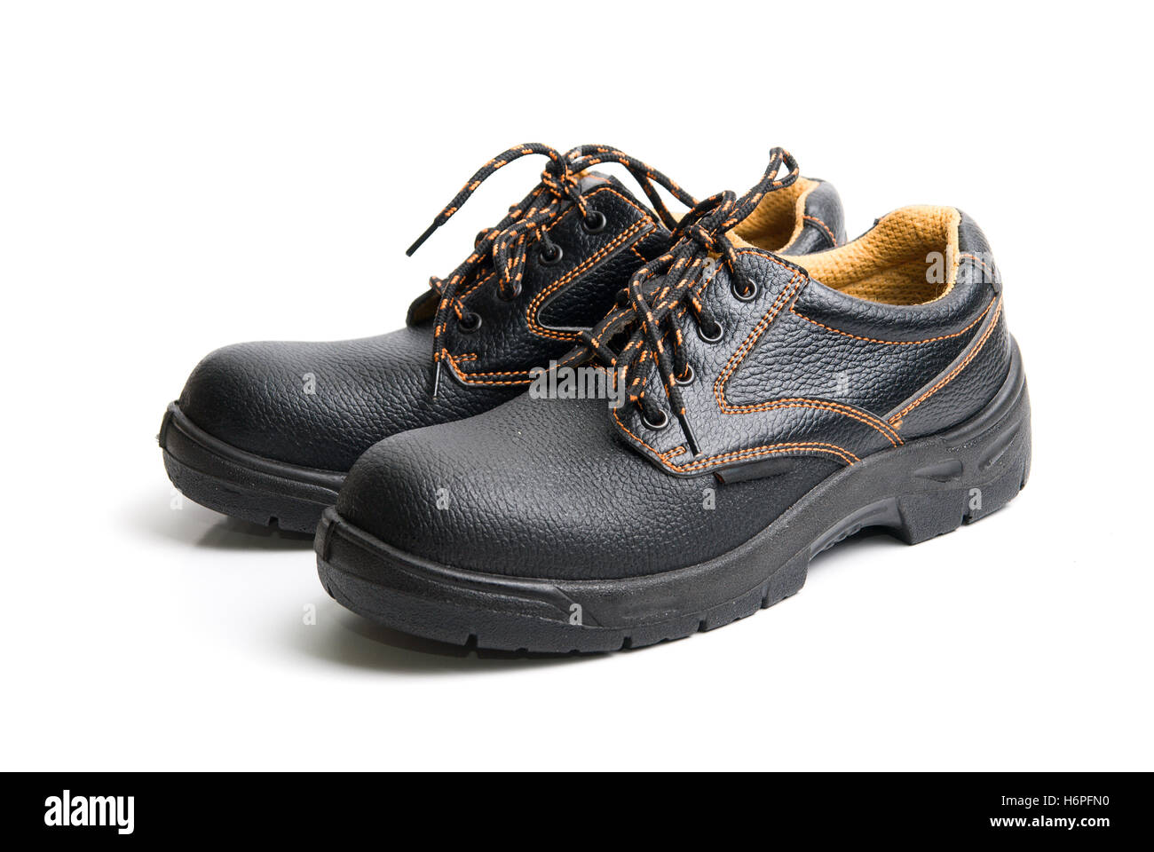 boot walk go going walking men man object travel isolated holiday vacation holidays vacations industry industrial - Stock Image