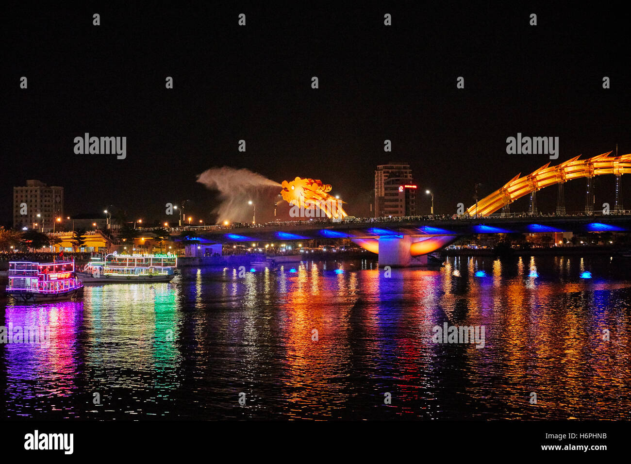 Dragon Bridge (Cau Rong) breathing steam. Da Nang city, Vietnam. - Stock Image