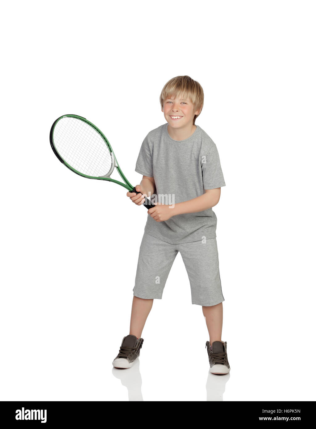 Preteen playing tennis holding racket isolated on white background - Stock Image