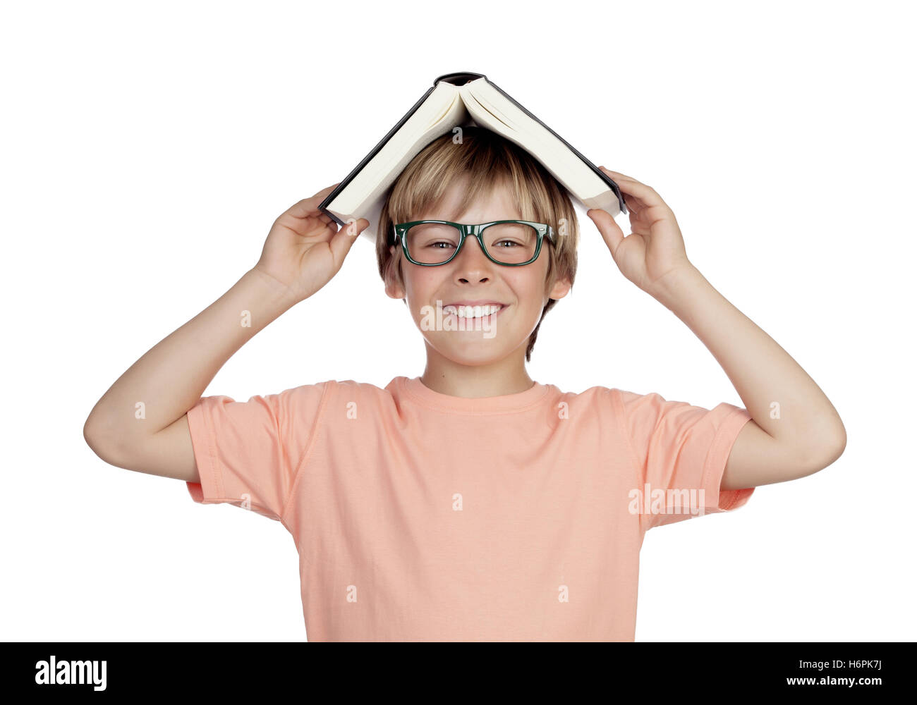 Preteen boy with a book and glasses isolated on white background - Stock Image