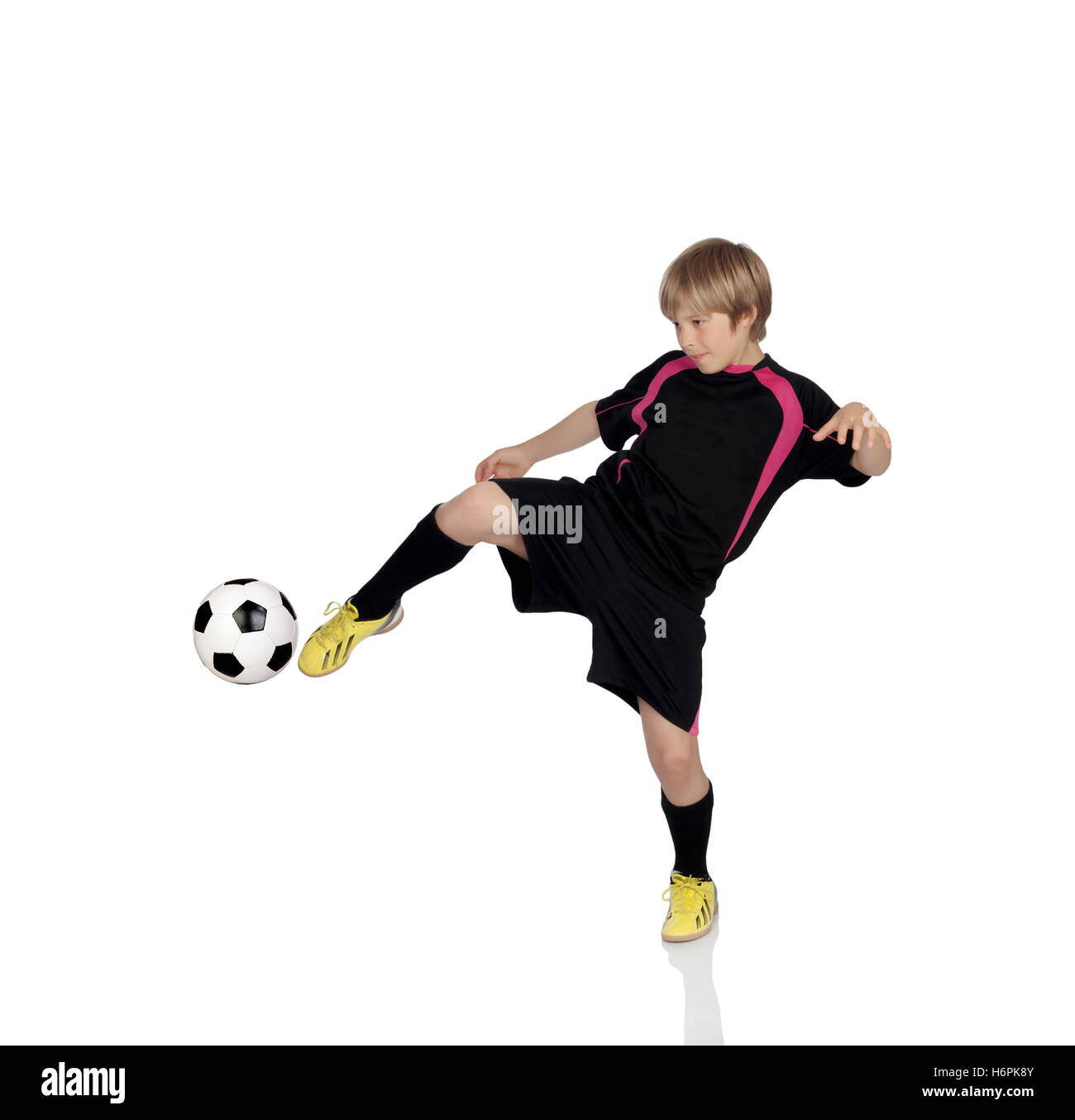 Preteen playing soccer isolated on a white background - Stock Image