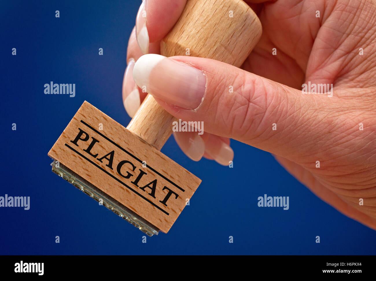plagiarism - stempel mit hand - Stock Image