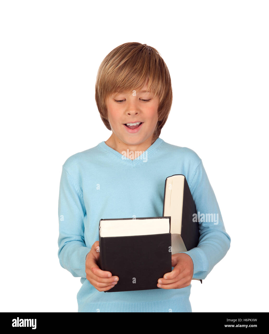 Surprised preteen boy with a book isolated on a white background - Stock Image
