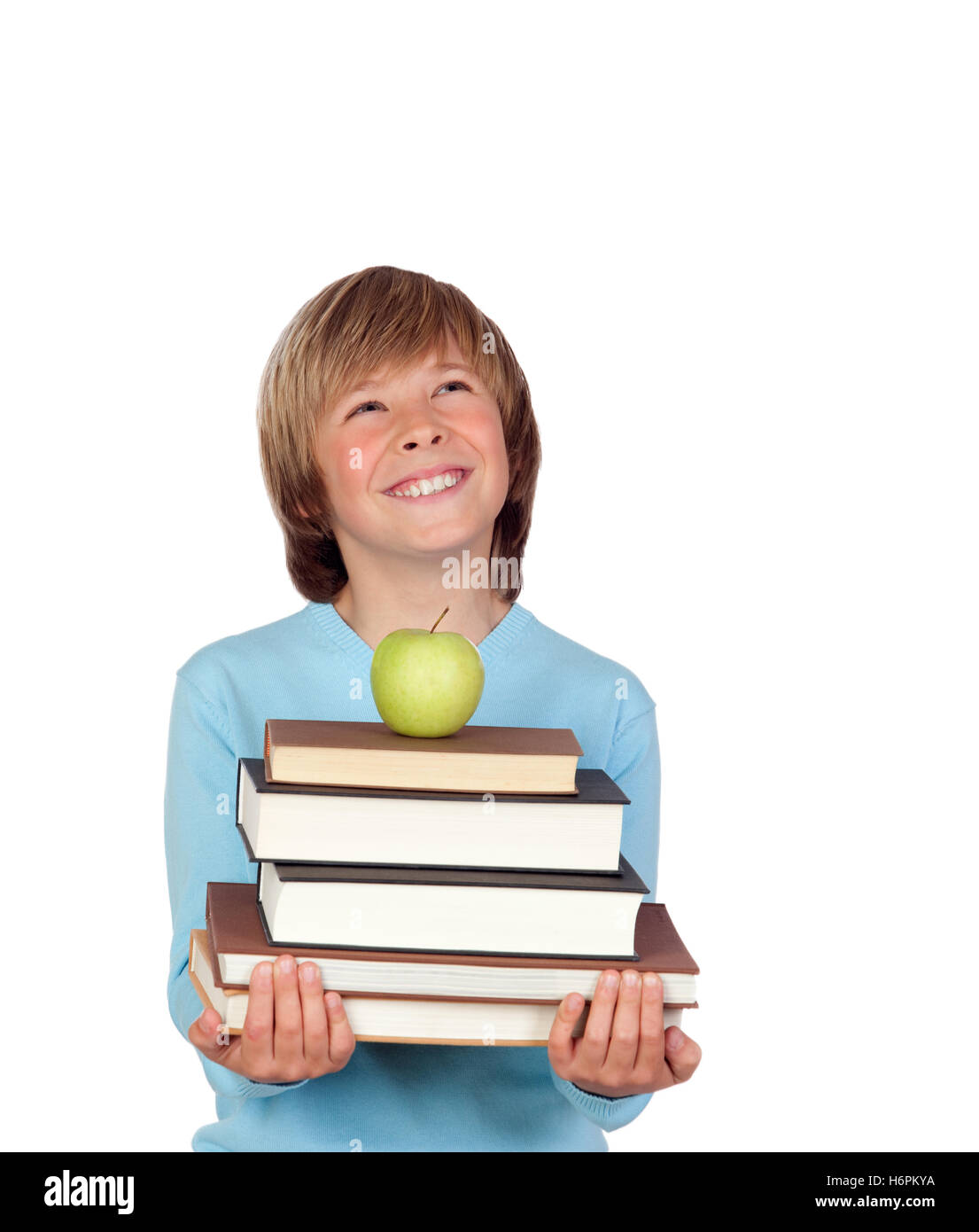 Preteen boy with a many books looking up isolated on white background - Stock Image