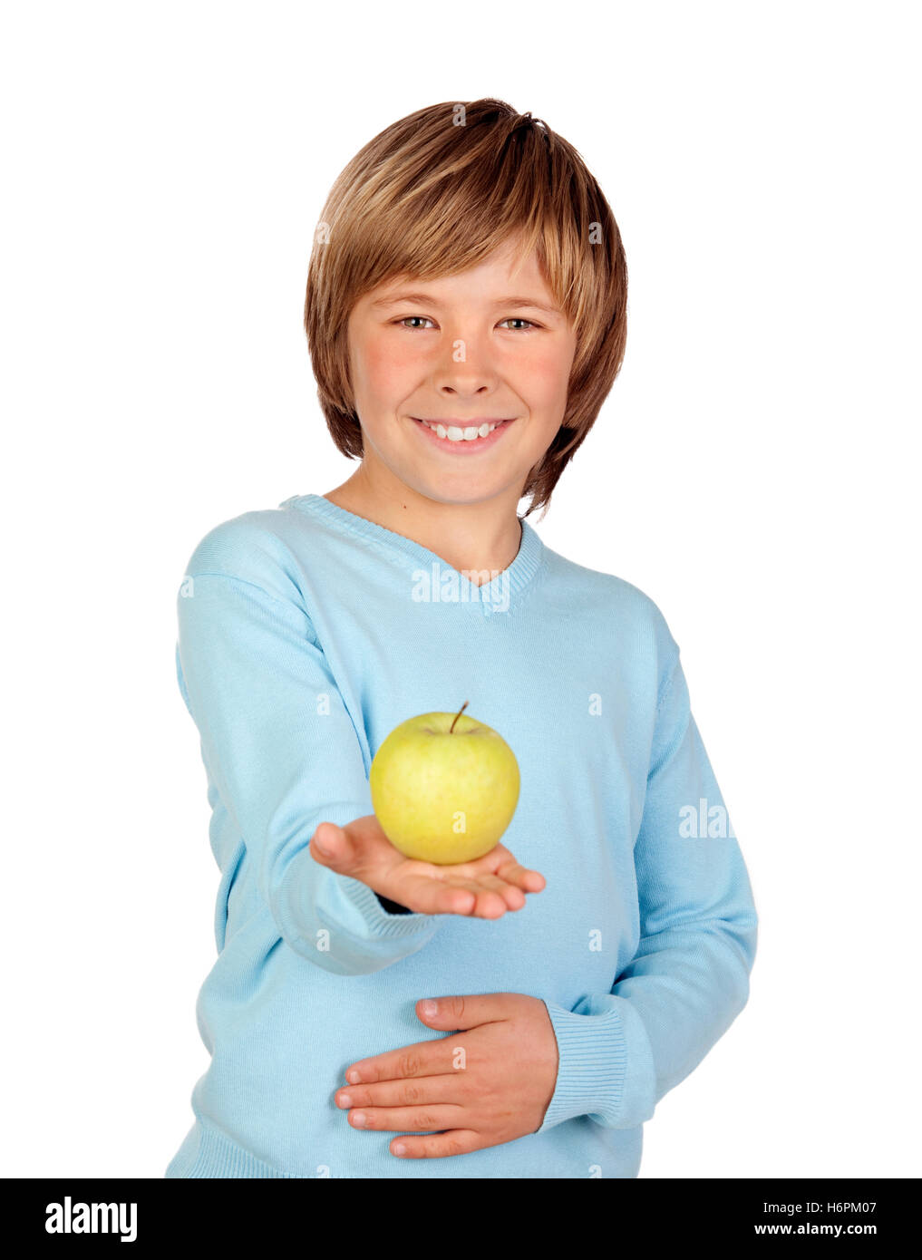 Preteen boy with a yellow apple isolated on white background - Stock Image