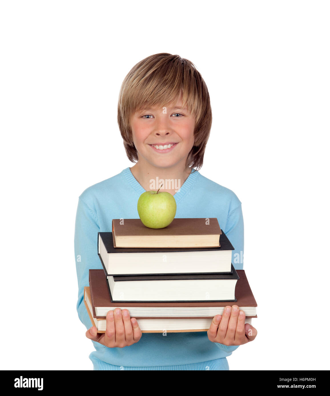 Preteen boy with a many books isolated on white background - Stock Image