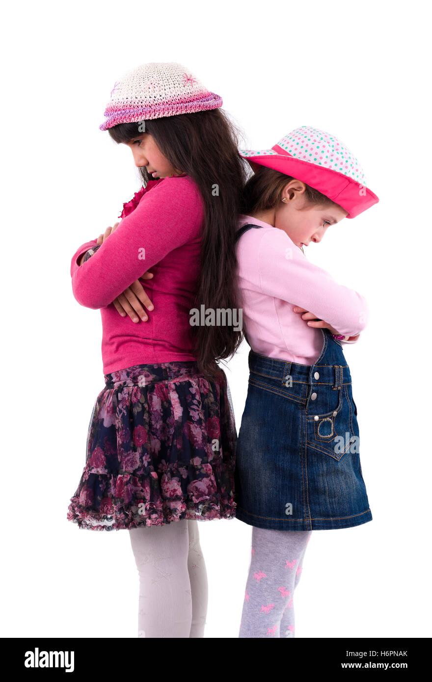 Two Sad Little Girls in Quarrel Isolated on White Background - Stock Image