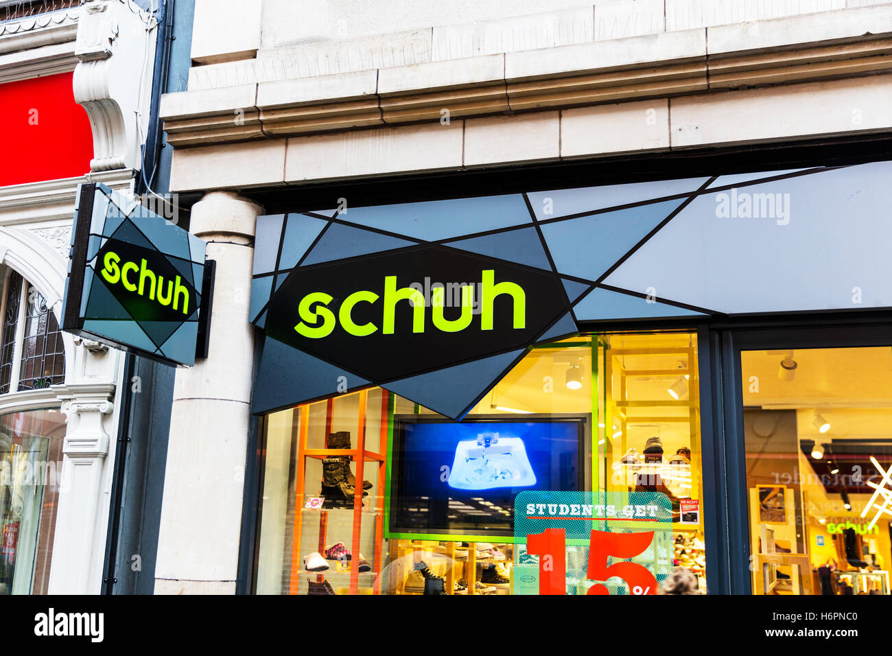 Schuh shoe shop footwear shoes clothing store high street shops Nottingham UK GB England sign exterior front facade - Stock Image