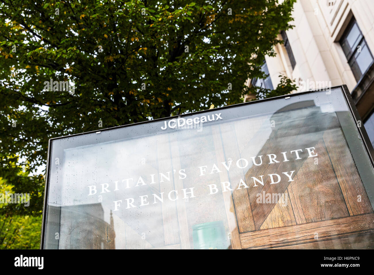 J C Decaux advertising company sign hording on high street advert company adverts on boards in Cities UK GB England - Stock Image
