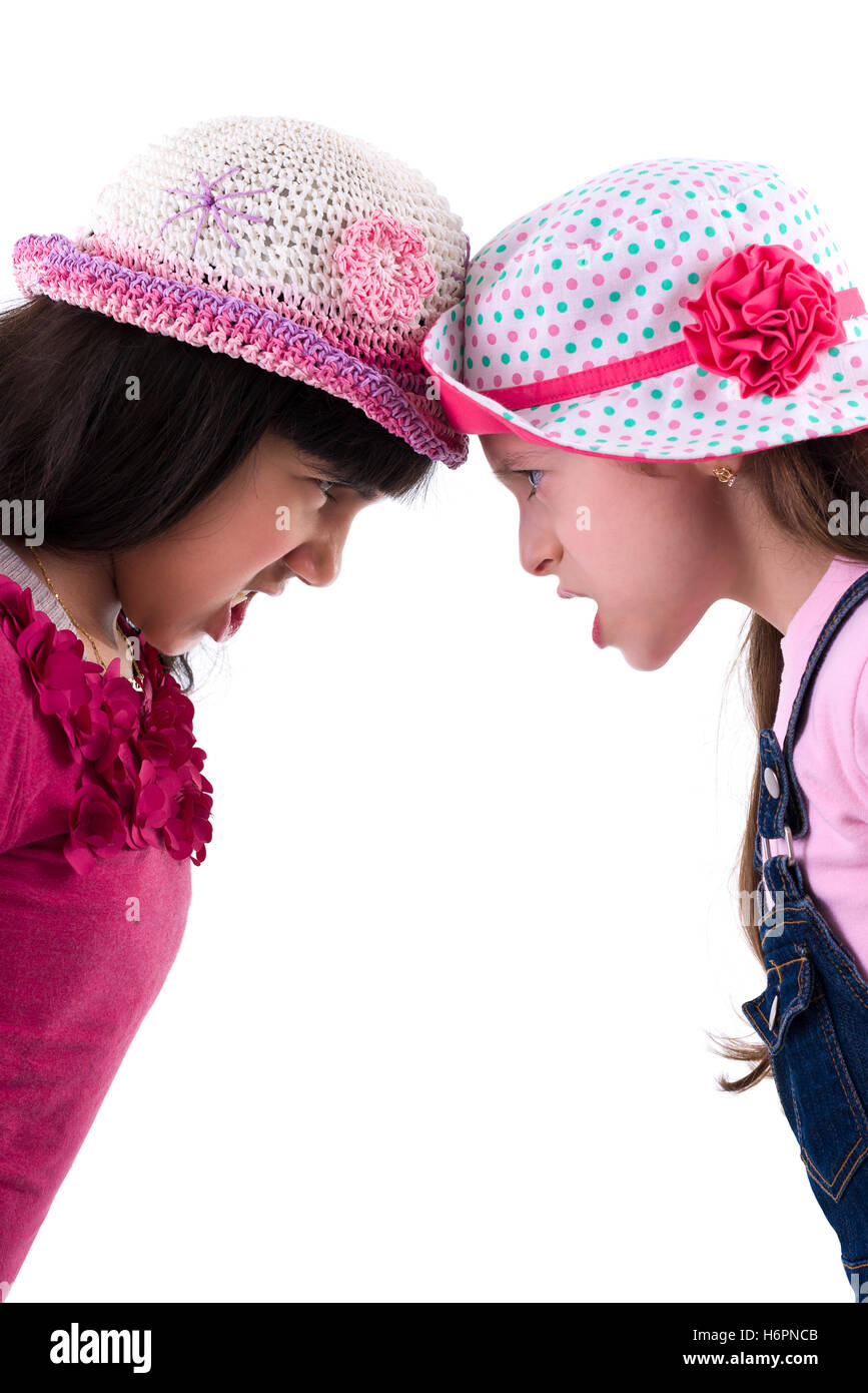 Two Sad Girls in Quarrel Isolated on White Background - Stock Image