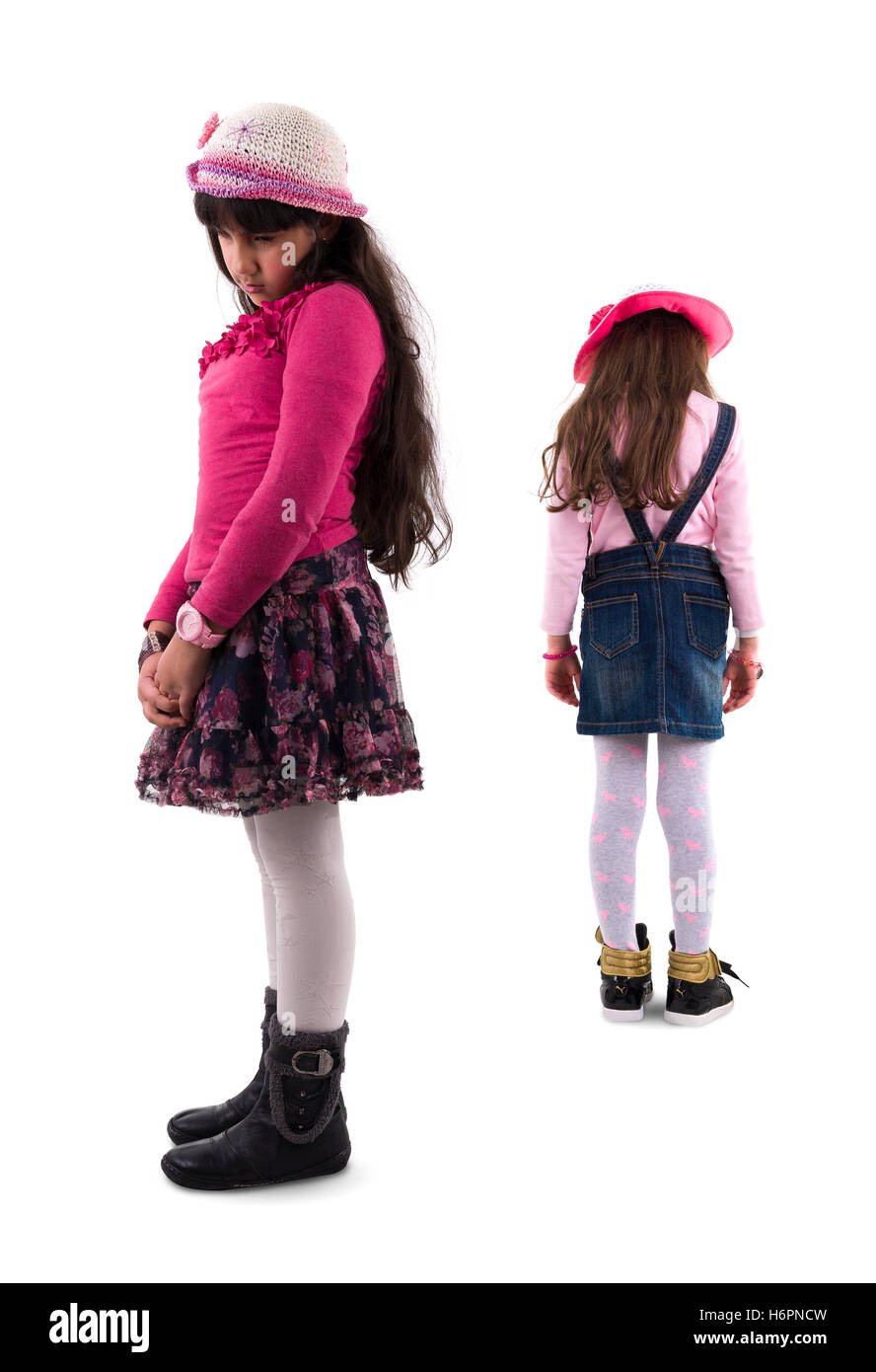 Two Young Sad Girls in Quarrel Isolated on White Background - Stock Image