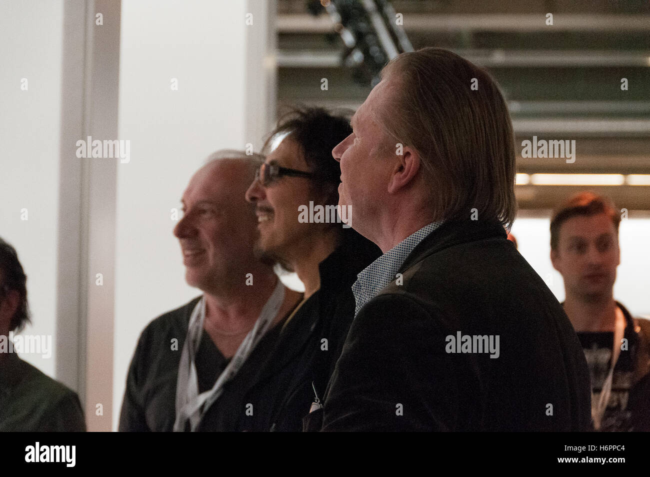 Neal Preston, Tony Iommi, Ralph-Jörg Wezorke (curator), visiting the Lightpower Collection at the Musikmesse - Stock Image