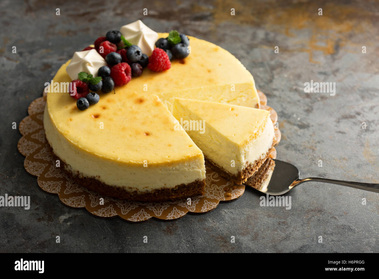 New York cheesecake on a cake stand - Stock Image