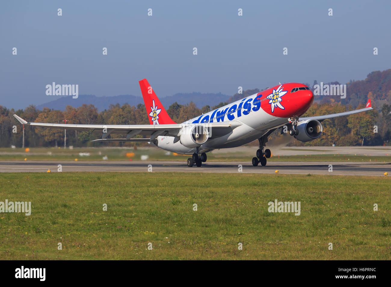 ZURICH - July 30: Edelweiss A330 take off at Terminal A of Zurich Airport on July 30, 2016 in Zurich, Switzerland - Stock Image