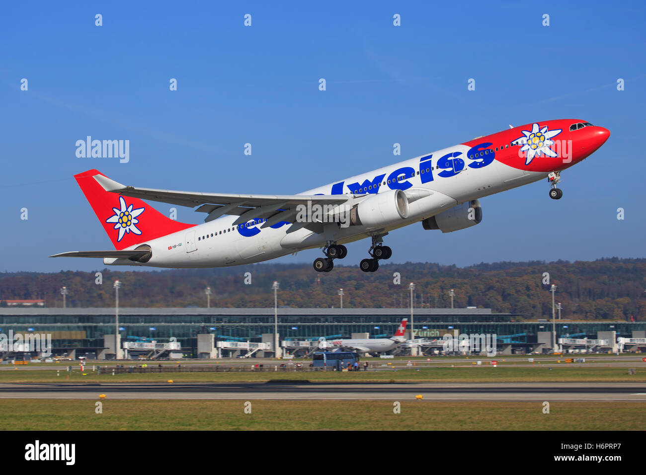 ZURICH - July 30: Edelweiss A330 take off at Terminal A of Zurich Airport on July 30, 2016 in Zurich, Switzerland - Stock Image