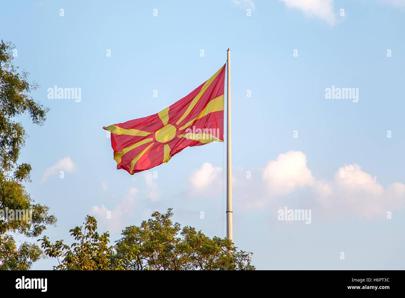 Macedonian flag wacing on a wind on a flagpole - Stock Image