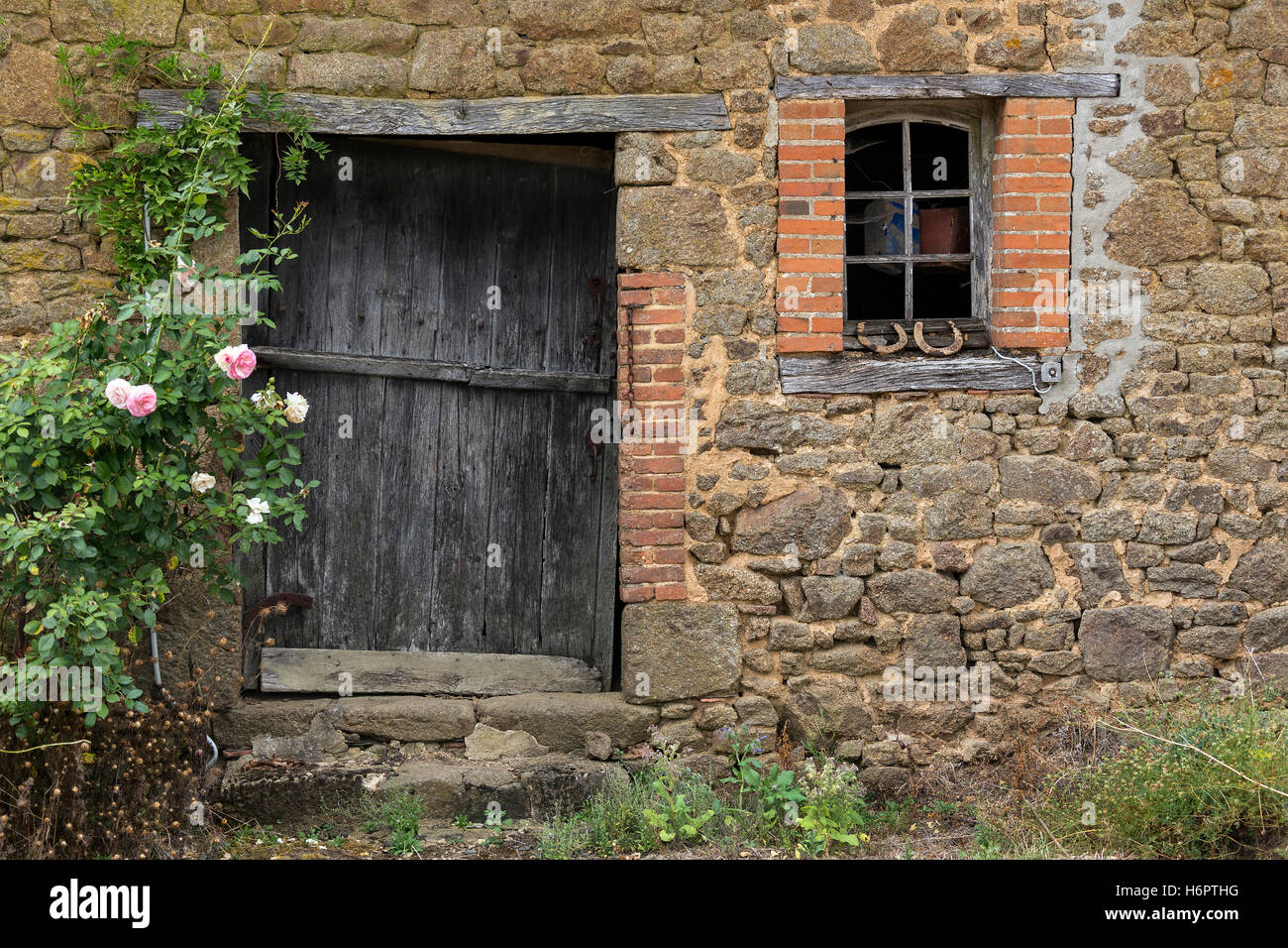 Exterior of a old agricultural building in northern France. - Stock Image