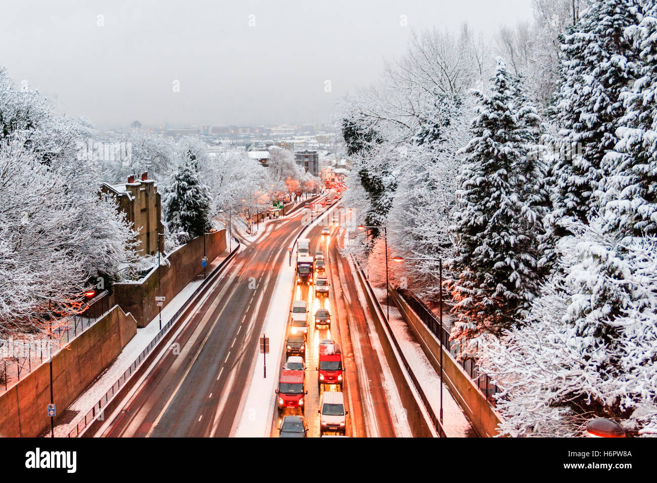 Snow causes delays and congestion on the northbound carriageway of the A1 Archway Road, London, UK, looking south - Stock Image