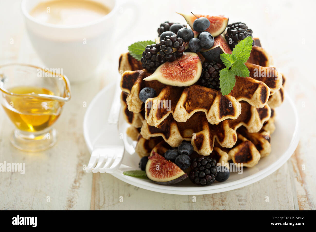 Fluffy breakfast waffles with fresh fruits Stock Photo