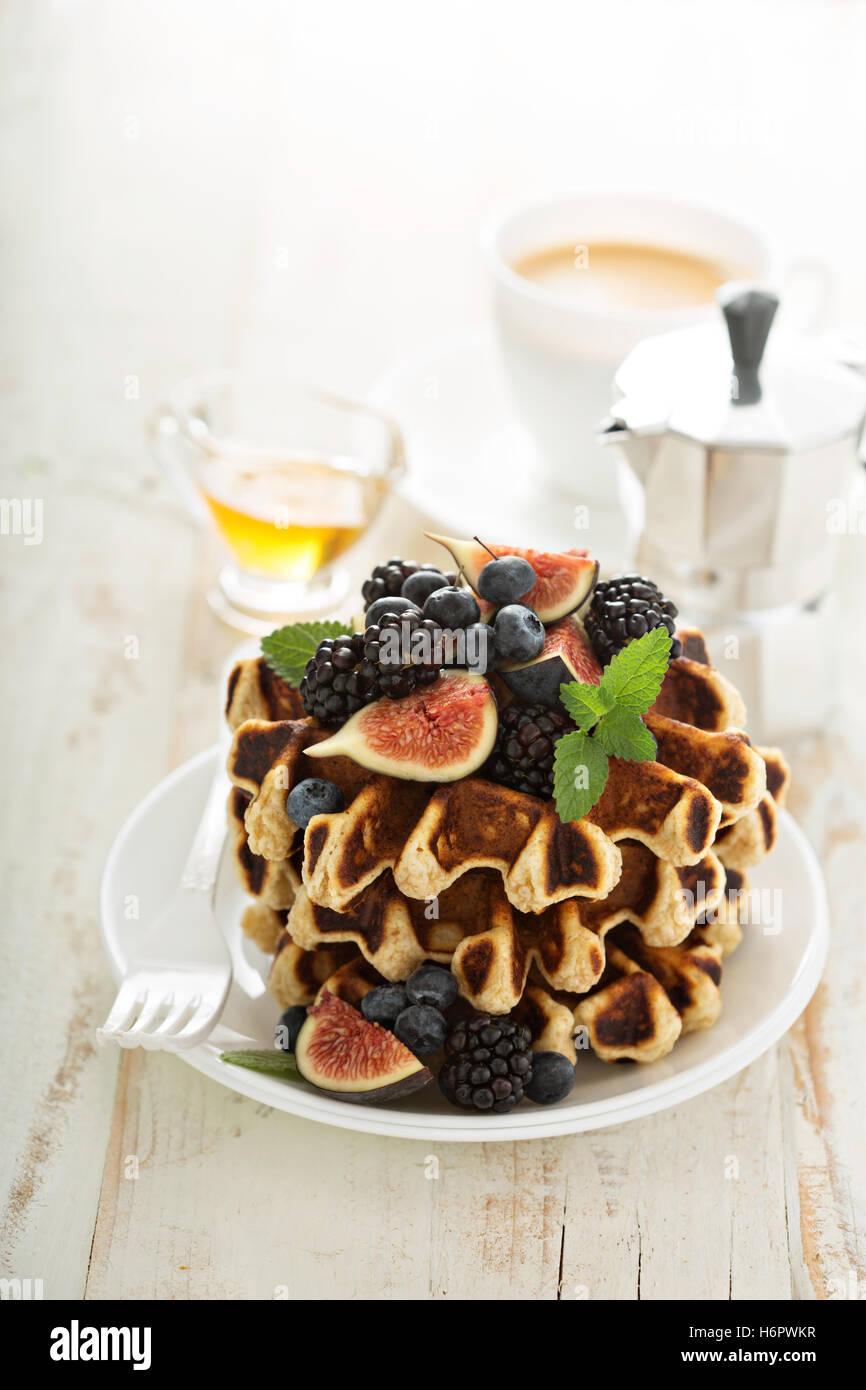 Fluffy breakfast waffles with fresh fruits Stock Photo