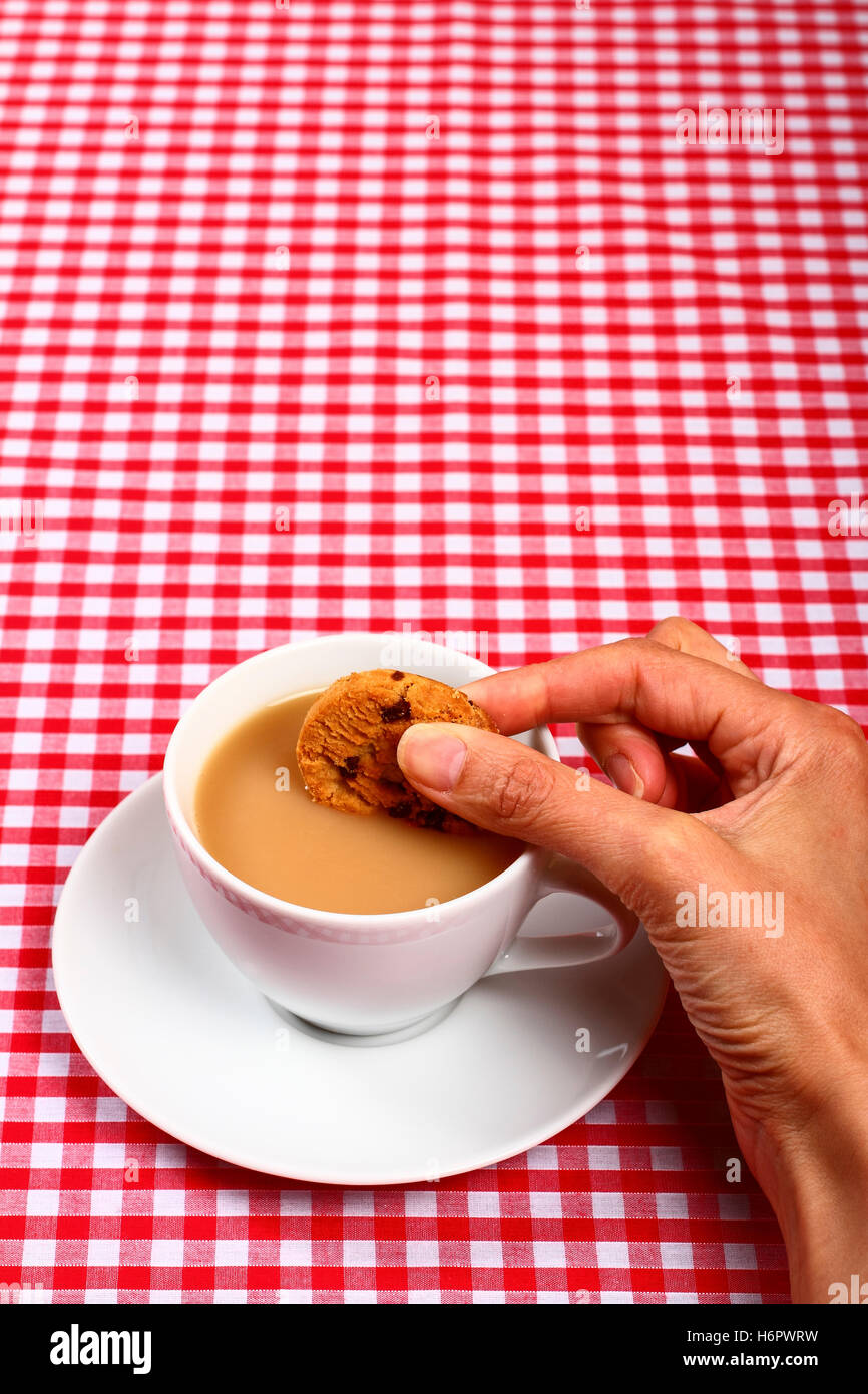Woman Ladies Girls Hand Dunking A Cookie Biscuit In To A Hot Cup Of Stock Photo Alamy