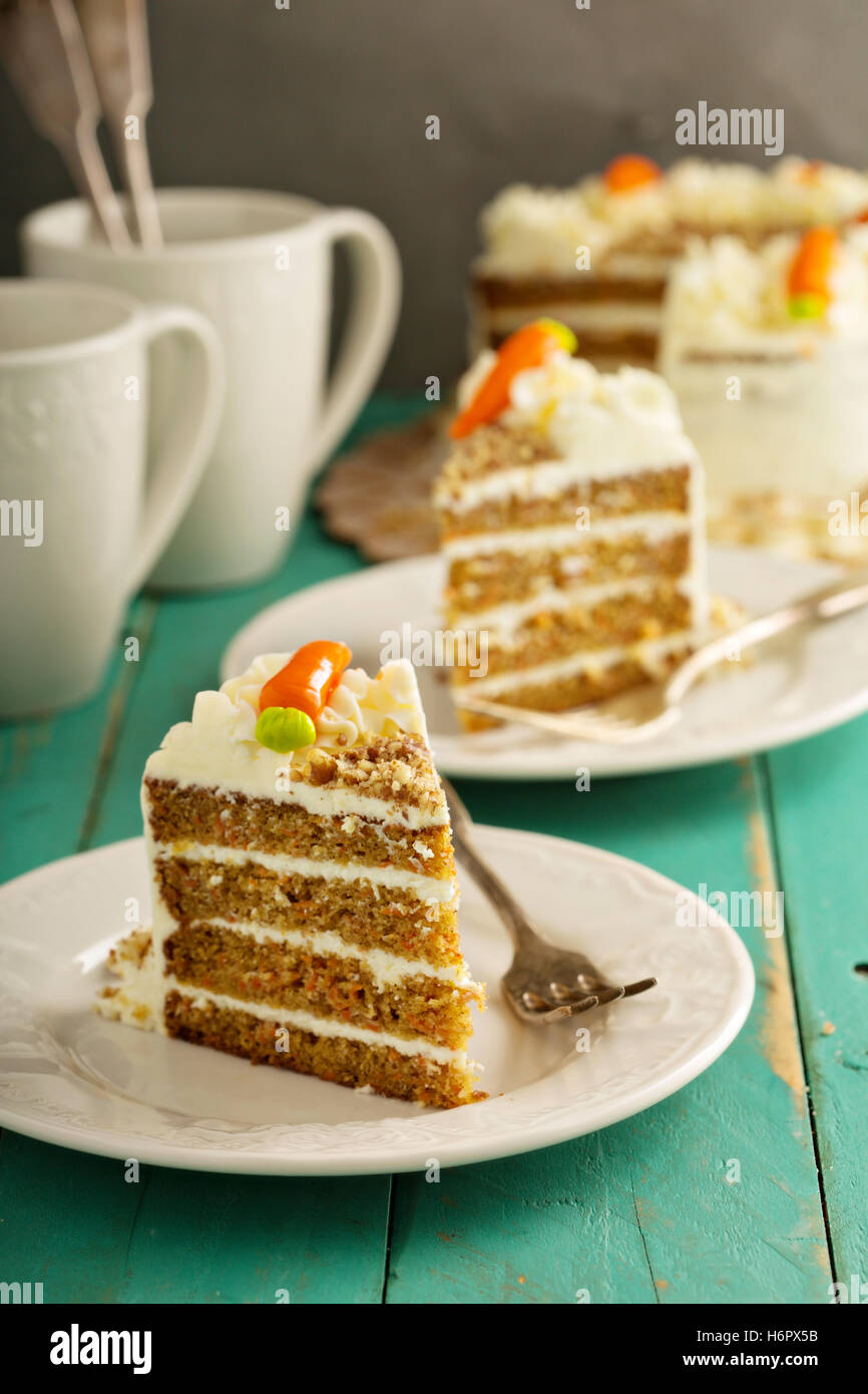 Slice of carrot cake with cream cheese frosting - Stock Image