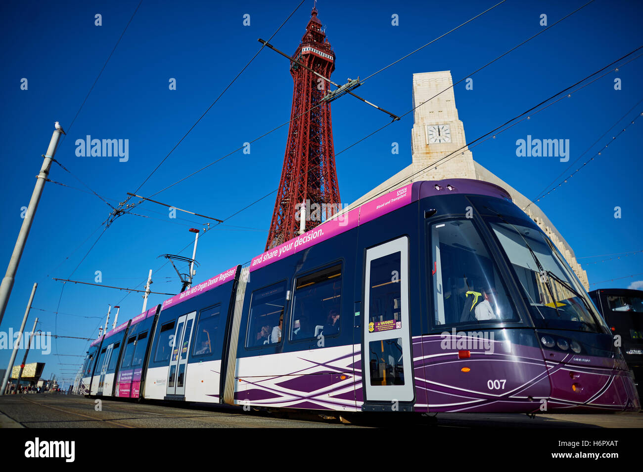 Blackpool ftower modern tram light rail  Holiday sea side town resort Lancashire tourist attractions  tower copyspace blue sky d Stock Photo